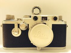 Vintage / retro Leica IIIF red dial camera with leitz viewfinder.