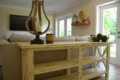This rustic farmhouse style console/entryway table is a solid pine construction and is available in any stain preference. Table can be used as an entertainment console table, foyer table or sofa table. All pieces are custom and may differ slightly from sample image. Sample image is in a distressed white finish that shows rich stain underneath. Each piece is triple coated in a natural wax that provides both protection and a beautiful smooth finish. The dimensions of the console table are...