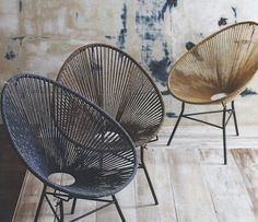 Ultra cool Ellipse Chairs update a vintage classic. Soft cotton cords have tonal variation due to a hand-dye process. Dark iron bases provide sturdy suppor