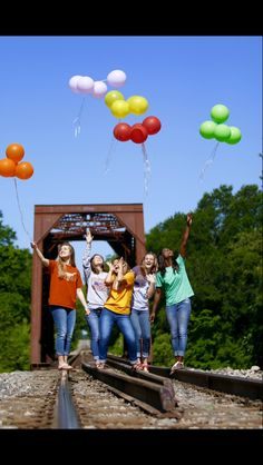 Senior Group pictures with my best friends! We're all wearing our future college shirts :)