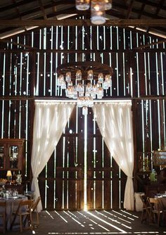 1000 ideas about wagon wheel light on pinterest wagon wheel chandelier wheel chandelier and wagon wheel table alternating length wagon wheel mason jar