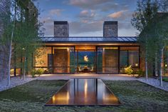 Gibeon Photography. Stone Exterior. Mountain Modern. Reflecting Pool.