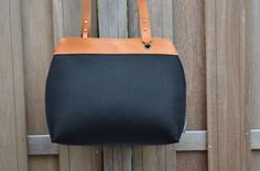 Fancy crossbody bag made of 100% black wool felt and finished with beautiful cognac colored saddle leather |||    Another variation, too large again, but so so gorgeous!