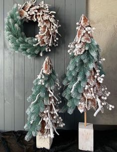 Creative idea for DIY an artificial tiny Christmas tree. This is the style I have never seen before but it looks so cool in this combination with a few the same trees and Xmas whreath. Christmas Flower Decorations, Unique Christmas Cards, Christmas Floral Arrangements, Christmas Flowers, Handmade Christmas, Christmas Wreaths, Christmas Crafts, Christmas Ornaments, Holiday Decor