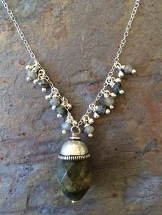 Labradorite faceted gemstones and sterling silver beads on a sterling silver necklace