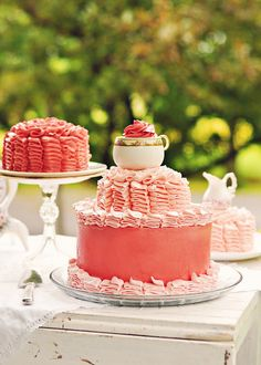 fantastically pretty pink ruffle cakes ... teacup on top  : )