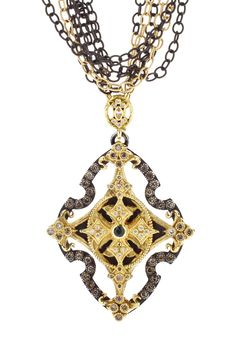 Old World midnight and 18K yellow-gold multi-strand necklace with large cross enhancer with diamonds and peacock tourmaline. Image property of Armenta.