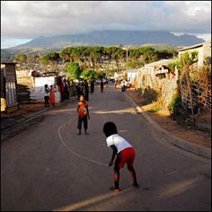 South African children skipping on a road in Kayamandi Township  (Photo by BBC News website reader Spencer Millsap)