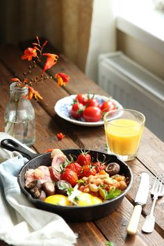 Eggs, Bacon, Mushrooms, Tomatoes and Beans make up a Full English Breakfast