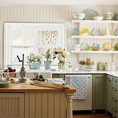 Love the blues, yellows, beadboard, island open shelves....ooohh, so many things.