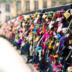 A bridge in Paris where couples go and place a pad lock on the bridge signifying there long lasting love together. I want to go there with that special person someday! <3 <3