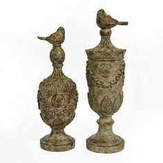 """Lovely decorative finial made of resin with an aged, weathered appearance. Set of 2 finished with song birds. 17"""" & 15"""" $79.95 No taxes. Free shipping"""