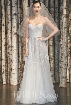 """Brides.com: . """"Portofino"""" strapless tulle A-line wedding dress with a sweetheart neckline and beaded floral motifs, Naeem Khan"""