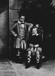A cute photoshoot of Prince Arthur posing with his little brother , prince Leopold . Great Britain, 1859