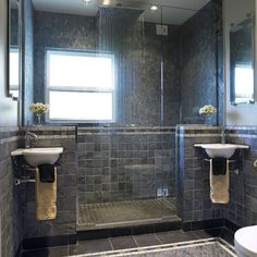 Darker stone, rain shower... Article: how to coax out space in a smaller bathroom