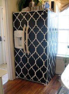 How to makeover an ugly appliance using matte contact paper....this would be fun a way to spruce up washer & dryers too...