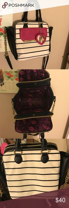 Betsey Johnson big striped bag Betsey Johnson- like new. Comes with mirror attached. Three large pockets, plus the small pink one on the outside. Inside looks brand new. Outside looks new except for a couple wrinkles/wear on the BACK of the bag from the two times I used it wearing new black pants   What you see in the pictures is exactly how it looks. Has handles and also chain link with leather long shoulder strap. Betsey Johnson Bags