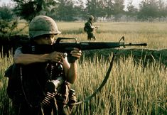 An American soldier fires his M16 rifle near My Lai on March 16, 1968 2400 × 1652