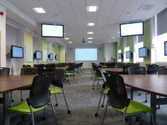 A flat room with ten group tables (8 seats) providing a comfortable collaborative learning space for at least 80 students. Each group has their own local PC and 42″ LCD screen which may also be dis…