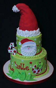 """5"""" white almond/8"""" choc/choc chip for Halle's 4th birthday.  Halle is having a special visitor attending her party!  Santa's hat is made from cake and rice krispie treats."""