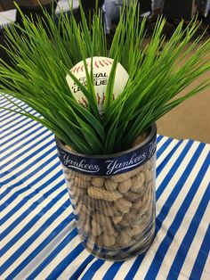 Baseball Theme Baby Shower   We loved these centerpieces that used peanuts, fake grass, and baseballs. The expectant mom also loved the personal touch of Yankees ribbon.