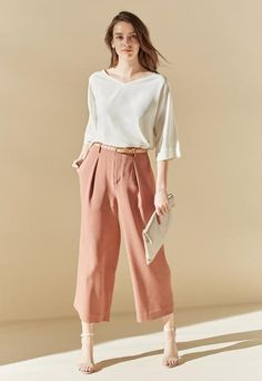 With a supple feel and low-key style, our Drape Wide Leg Ankle Pants add a trendy flare to your look.