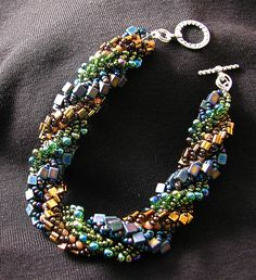 This triple spiral, with 3 colored bands, is so much fun to make. You get to use so many different beads (if you want) it just never gets boring. I learned the triple spiral stitch doing the pattern Sumptuous Spiral by Nancy Sathre-Vogel in Dec 06/Jan 07 issue of Beadwork.