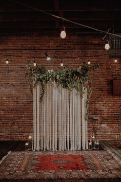 Boho-inspired ceremony space featuring lush greenery, a patterned rug, and candl. Boho-inspired ceremony space featuring lush greenery, a patterned rug, and candles Indoor Wedding Ceremonies, Wedding Ceremony Decorations, Wedding Backdrops, Decor Wedding, Industrial Wedding Decor, Table Wedding, Church Wedding, Party Wedding, Wedding Centerpieces