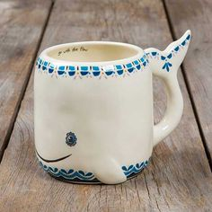 "Whale Folk Art Mug - This folk art mug will have you smiling every time you drink from it! It features an adorable whale design and the sweet sentiment, ""Go with the Flow"" on the inside! This hand sculpted, ceramic mugs is microwave and dishwasher safe."
