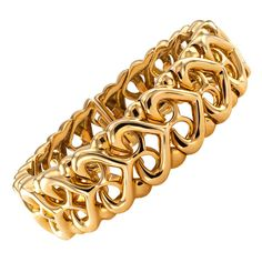 Bulgari Gold Cuff Bracelet. This Bulgari openwork designed cuff bracelet composed by a series of interlocking heart-shaped motifs, is a very fine example of a high quality estate jewelry, which is very wearable. 17 mm. wide, signed Bulgari, in 18 karat gold.