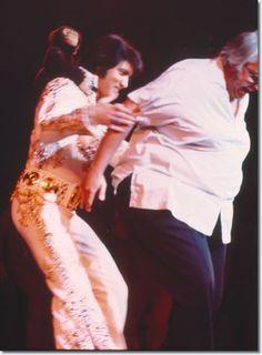 Elvis having a little fun with close friend and Memphis Mafia member, Lamar Fike : September 3, 1973