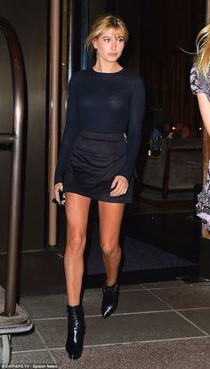 Short and sweet! Hailey Baldwin donned a failsafe black top and mini skirt when she was sp...