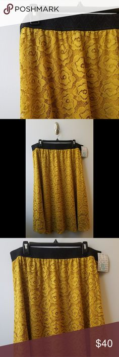 LuLaRoe Lola Skirt NWT Size 2XL Brand new with tags! Golden yellow color. Lined. Black stretch waist band.  Included photos of gently used 2XL Classic T that matches the skirt. Can include as part of bundle, for negotiated price. Comment below if interested.  No trades. Prompt and secure shipping. LuLaRoe Skirts