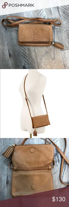 Tory Burch Crossbody Bag Great condition!  Authentic Tory Burch Thea Mini Fold-Over Cross-Body is made of pebbled leather and features a removable strap so it can be worn messenger-style or carried as a chic clutch. This must-have compact accessory is great for holding a day or evening's worth of small essentials. Tory Burch Bags Crossbody Bags