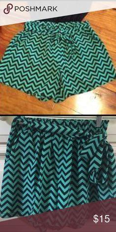 BeBop Green/Navy Chevron Shorts Brand New. Chevron Print. Side Pockets. Tie Belt. 100% Polyester. BeBop Shorts