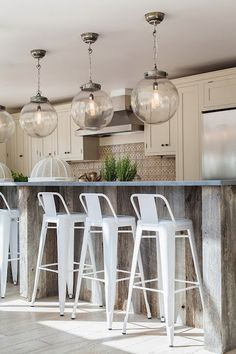 reclaimed wood planked island, gray countertops, Arteriors Reeve Pendants