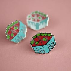 This sweet little basket of strawberries measures 1 wide and is hard enamel with a silver finish. Comes with a rubber clutch and all the good childhood memories of ravenously devouring fresh berries.