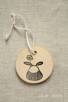 hand draw illustrations on thin wood planks for gifts or tags