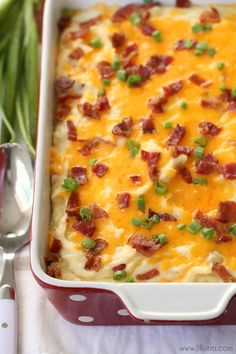 Loaded Mashed Potatoes Casserole - this side dish is AMAZING! It's filled with potatoes, cream cheese, sour cream, butter, cheese, bacon and more. It's easy too - definitely a new family favorite!