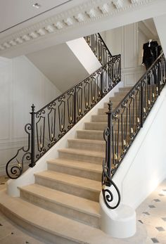 The Balmain store in Paris by Joseph Dirand, elegant Parisian interior with moldings mixed with modern style _