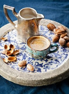 Coffee cup with almonds by liskina-nora on @creativemarket
