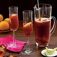 Winter Sangria Recipe  1 cup fresh satsuma orange juice (about 4 satsumas)   1 cup satsuma orange sections (about 2 satsumas)   1/3 cup Triple Sec (orange-flavored liqueur)   1/4 cup sugar $          2 whole cloves   1 cinnamon stick   1 lemon, cut into 8 wedges   1 lime, cut into 8 wedges   1 (750-milliliter) bottle fruity red wine $