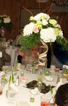 My tall wedding centerpieces. With the help of some friends and family members, we were able to create our own wedding centerpieces at home the day before the wedding.