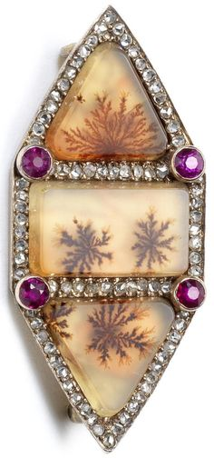 An antique moss agate brooch, Fabergé, workmaster Michael Perchin, St. Petersburg, circa 1890. The hexagonal façade composed of three moss agate sections within rose-cut diamond borders, set with rubies and gems, 56 standard, length: 3.7cm.