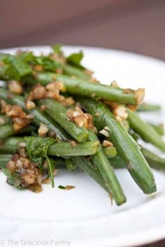 Clean Eating Garlicky Green Beans with Shallots will liven up the dullest dinner plate with tons of flavor! Find this clean eating recipe and over 1000 more at TheGraciousPantry.com.