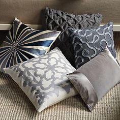 nice pinch technique to create diamonds (top pillow) and fancy ribbon sewed on in waves/swirls (top right pillow)