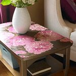 Wooden side table with pink flower design on top...make a boring end table flavorful with a splash of color...=)