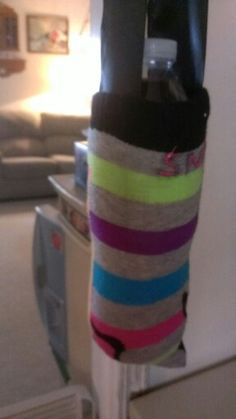 Water bottle holder from a sock  Cut a tube sock, turn inside out, sew end, add a strap, viola!!!!