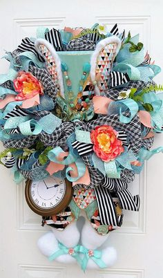 What a Statement you will make with this Beautiful Easter Door Wreath! This extra large Easter Wreath will be the envy of your neighborhood! It measures approx 28 -30 wide and 38 from top to bottom of bunny feet. The bunny was handmade by a wonderful artisan and the details are