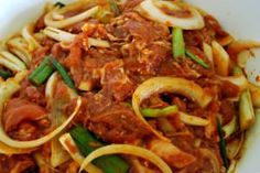 This spicy pork bulgogi is a popular Korean BBQ. Thinly sliced pork is marinated in a gochujang based sauce typically with lots of fresh garlic and ginger.